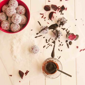 Red velvet truffles with homemade chocolate sauce