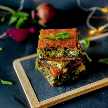 Vegan spanakopita with a beetroot dough